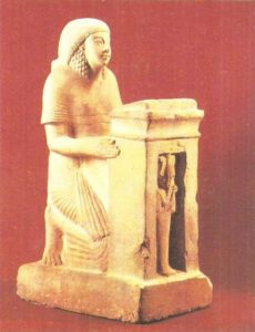 Kneeling with naos. Dynasty XVIII.