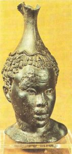 A bronze vessel in the shape of a negro's head. 100 BC Hellenism