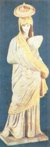 A woman with a fan. A Tanagra statuette. Terracotta. End of the IV century BC.