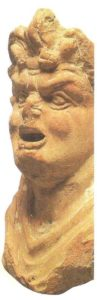 The upper part of the statuette of an actor in a tragic mask. Terracotta. II-early I century BC.